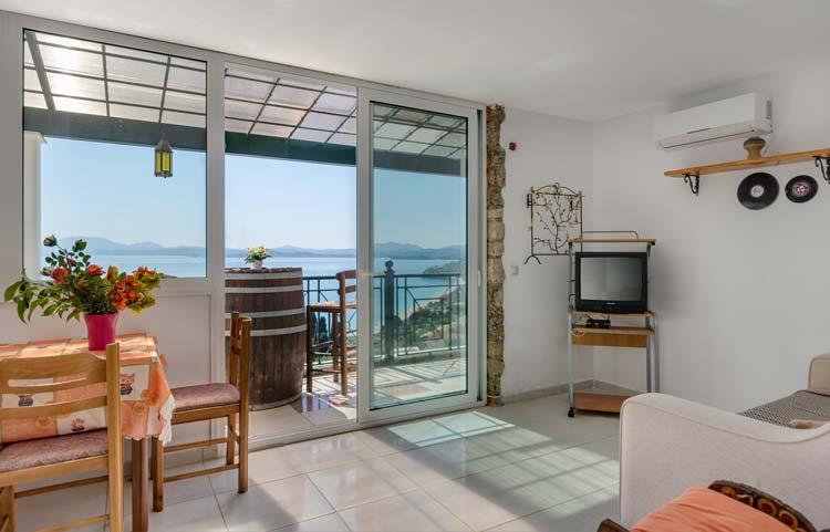 sarakinos-apartments-barbati-2bd55-livingroom-01